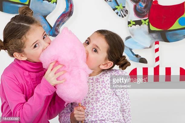 Happy friends having fun at amusement park - studio shot