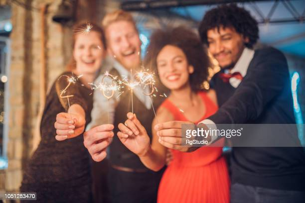 happy friends holding sparklers - 2019 stock pictures, royalty-free photos & images