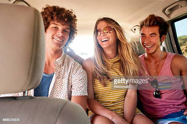 Happy friends in a car