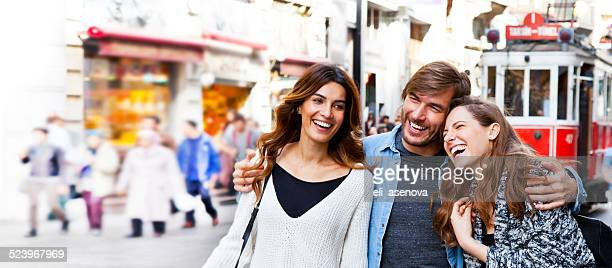happy friends in istanbul. - global fashion collective stock pictures, royalty-free photos & images