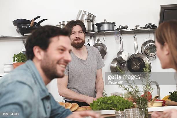 Happy friends in kitchen
