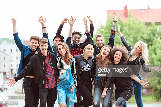 happy friends in the city - izusek stock photos and pictures