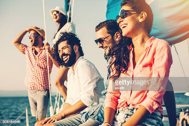 happy friends on a yacht - nautical vessel stock pictures, royalty-free photos & images
