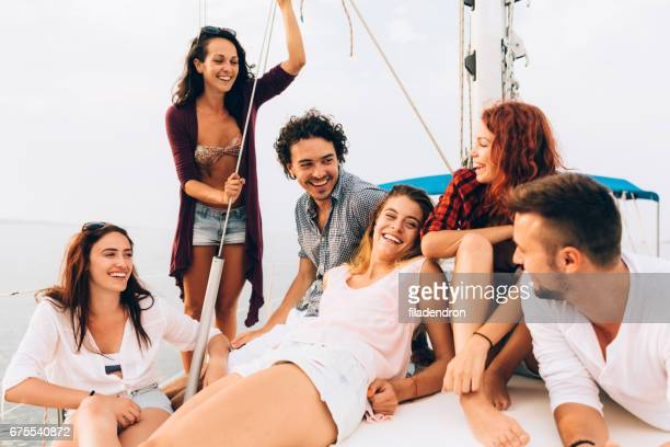 happy friends on a yacht - tourboat stock pictures, royalty-free photos & images
