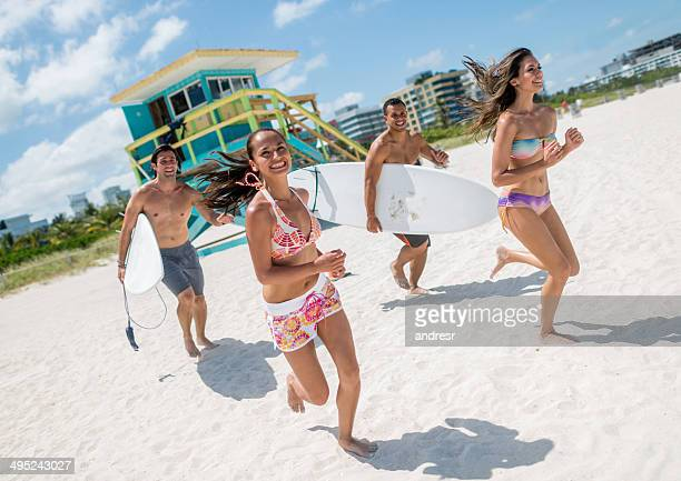 happy friends on vacation - miami beach stock pictures, royalty-free photos & images