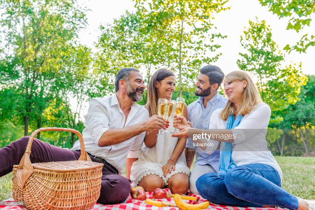 Happy friends or family with glasses of champagne : Stock Photo