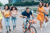happy friends riding bicycle make fun