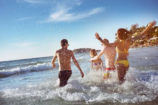 Happy friends sea beach holidays 859997320