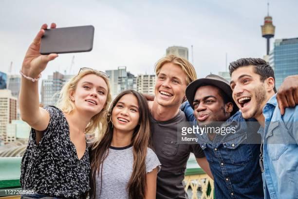 Happy Friends shooting Selfies Darling Harbour Sydney