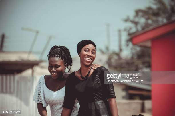 happy friends standing outdoors - ghana stock pictures, royalty-free photos & images
