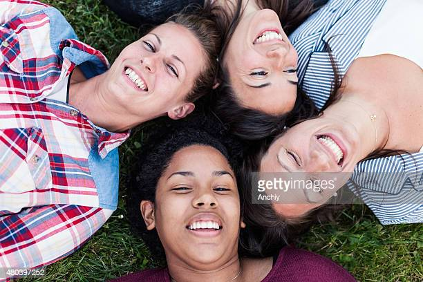 Happy friends taking selfie and laughing.