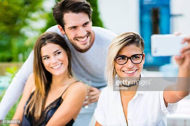 happy friends taking selfie with smartphone - provinz lerida stock-fotos und bilder