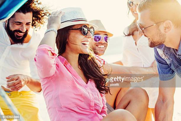 Happy friends traveling on yacht