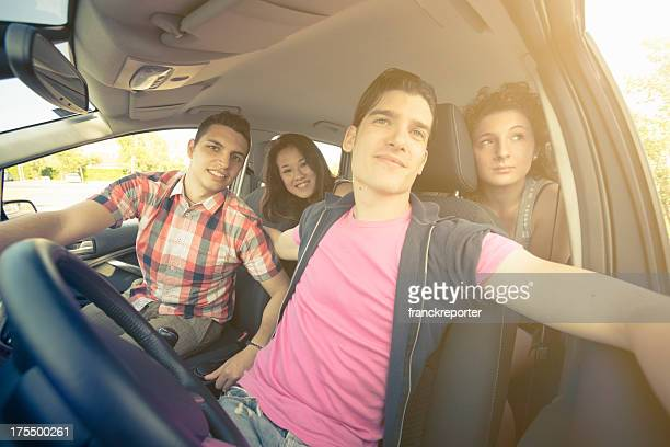 Happy friendship ready for a vacation inside car