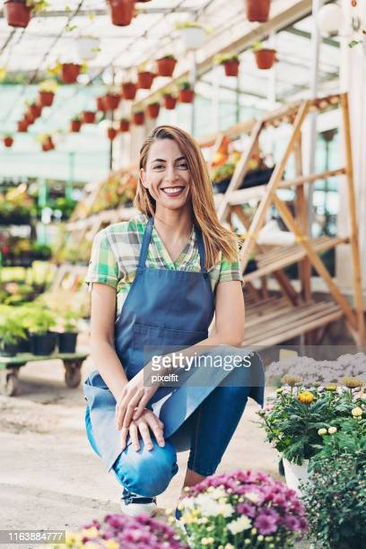 happy garden center owner - part time job stock pictures, royalty-free photos & images
