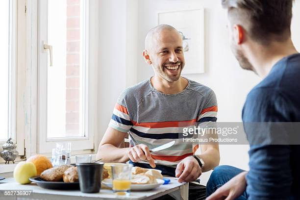 happy gay couple having breakfast - gay love photos et images de collection