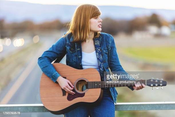 happy generation z female with guitar outdoors on overpass photo series - eyecrave  stock pictures, royalty-free photos & images