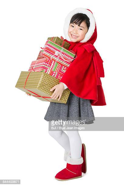 Happy girl and Christmas gifts