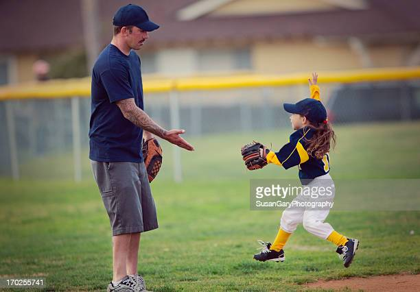 happy girl and father at t-ball game - sport stock pictures, royalty-free photos & images