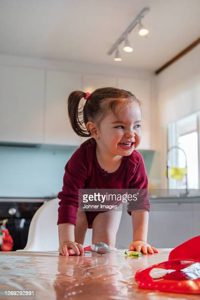 happy girl at table - children only stock pictures, royalty-free photos & images
