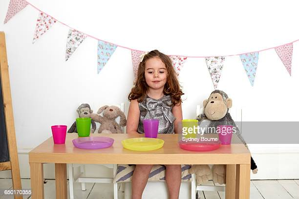 happy girl at tea party with soft toys - tea party stock pictures, royalty-free photos & images