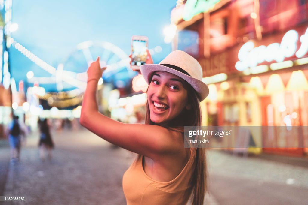 Happy girl at the amusement park : Stock Photo