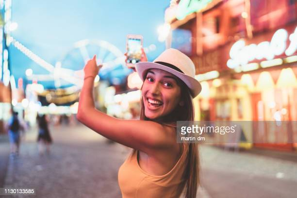 happy girl at the amusement park - influencer stock pictures, royalty-free photos & images