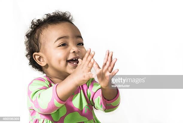 Happy beautiful girl claps in delight
