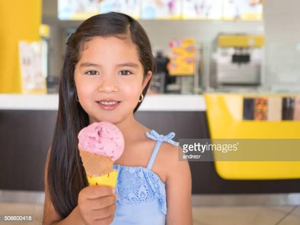 Happy girl eating an ice cream