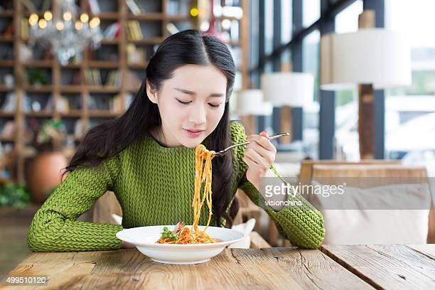 happy girl enjoy pasta
