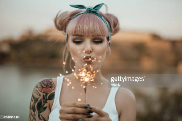 Happy girl holding burning sparklers