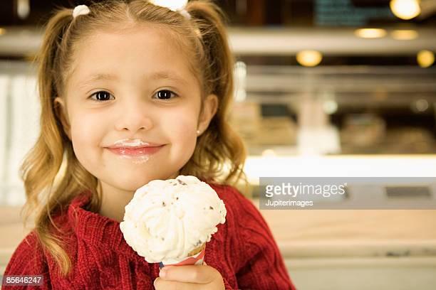 Happy girl holding ice cream cone
