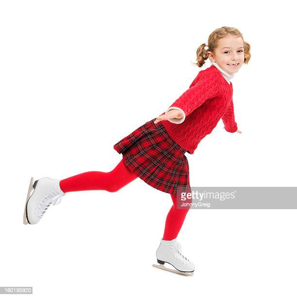 happy girl ice-skating - girls in plaid skirts stock photos and pictures