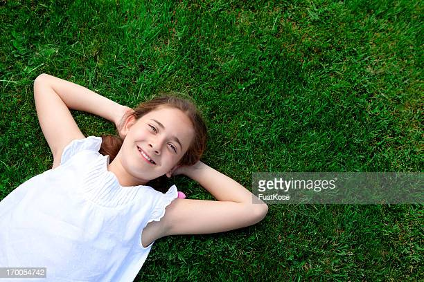 Happy girl in a grass.
