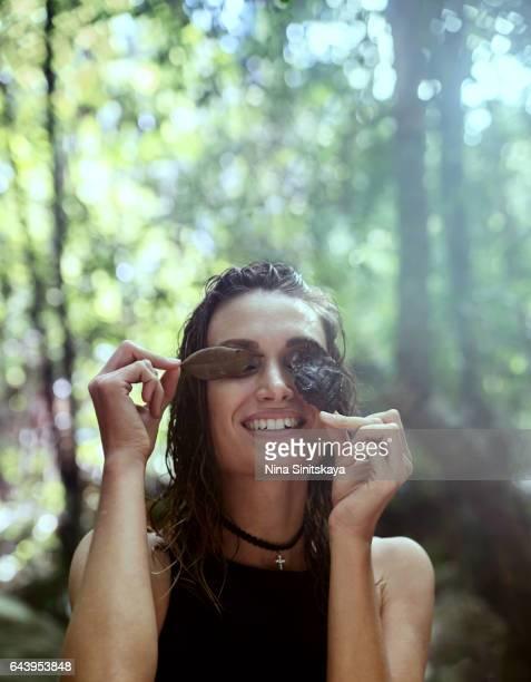 Happy girl in black swimwear laughing in rainforest
