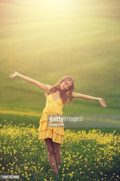 happy girl in flower covered field