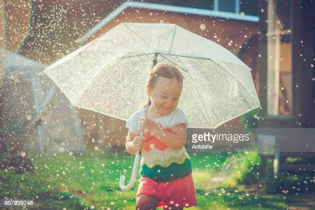 happy girl in rain - little russian girls stock photos and pictures