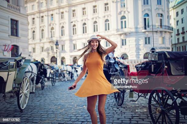 happy girl is walking and dancing on the street - vienna austria stock pictures, royalty-free photos & images