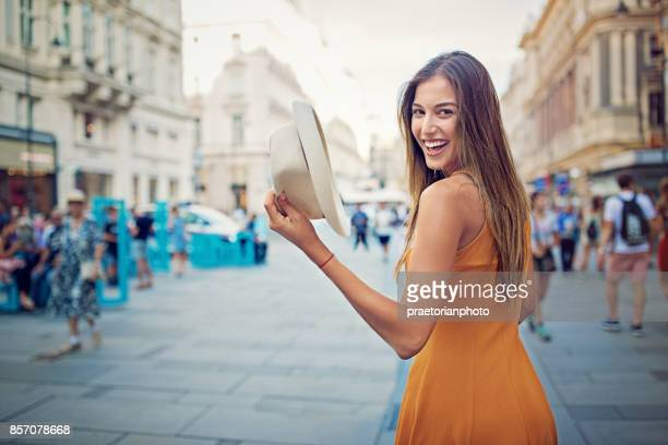 Happy girl is walking in the city center pedestrian zone