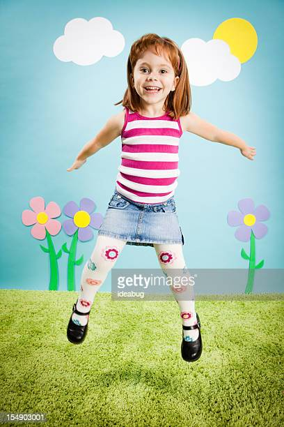 Happy Girl Jumping with Excitement in Whimsical Outdoor World
