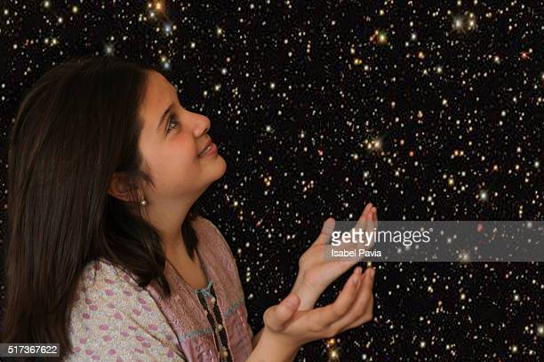 Happy girl looking at starry sky