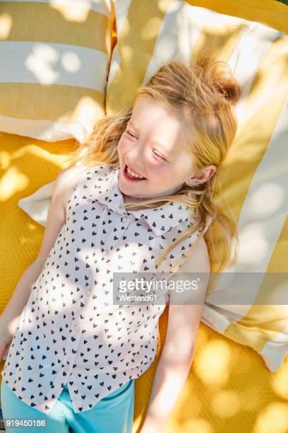 Happy girl lying on a blanket