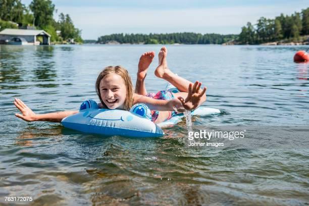 Happy girl on inflatable raft