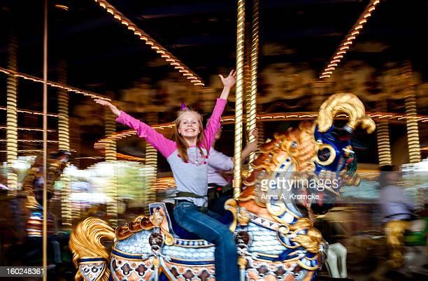 happy girl on merry-go-round