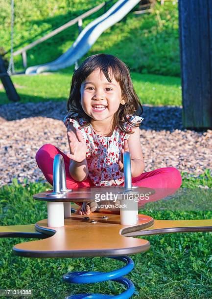 Happy Girl on seesaw