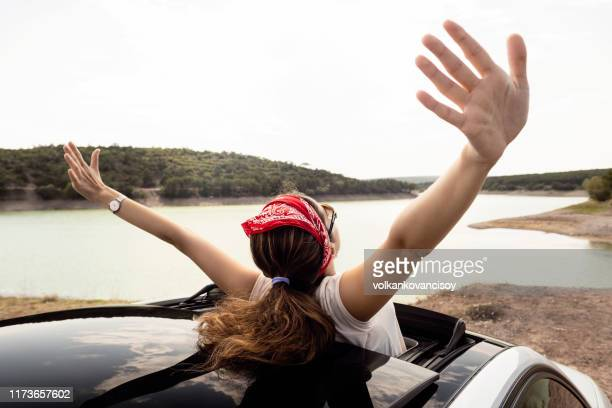 happy girl on the car - bandana stock pictures, royalty-free photos & images