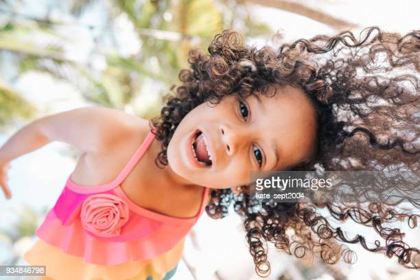 happy girl on vacations - curly stock pictures, royalty-free photos & images