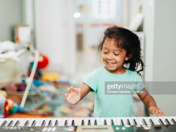 happy girl playing at home - hamiltonmusical stock pictures, royalty-free photos & images