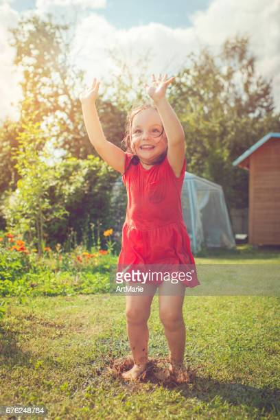 happy girl playing outdoors in summer - hot dirty girl stock photos and pictures