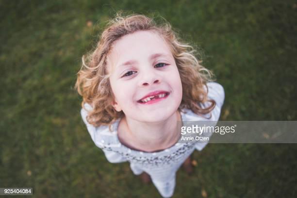 Happy Girl sanding outside smiling